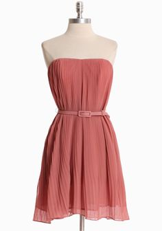 Spring Breeze Pleated Dress In Dusty Pink 52.99 This dusty pink tunic dress is perfected with soft accordion pleats, boning and  anti-slip lining at the bust. Finished with an optional waist-defining  belt. Fully lined.  100% Polyester , Imported , 29'' length from top of bust