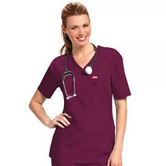 Orange Standard Unisex Balboa Top in Wine. The Orange Standard Unisex Balboa Top is designed to be worn by men and women. It comes in a variety of colours and sizes to cater for all tastes in your department. This scrub top has multi-compartment pocket details and a small D-ring on the chest pocket for your ID badge. £16.99  #nursescrubs #dentistuniform #nurses #dentists #redscrubs