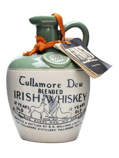 Tullamore Dew 12 Year Old Ceramic Decanter / Bot.1960s : Buy Online - The Whisky Exchange - A ceramic crock of Tullamore Dew's 12 year old whisky from the 1960s.