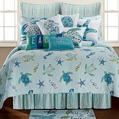 Pay homage to the beauty of the sea with the extraordinary Imperial Coast Quilt. Showcasing an ocean life motif with sea turtles, star fish, and sea horses swimming on a blue background, this soothing quilt brings a coastal touch to your bedroom. Nautical Bedding, Coastal Bedding, Coastal Bedrooms, Coastal Living Rooms, Luxury Bedding, Beach Bedrooms, Coastal Quilts, Coastal Rugs, Beach Theme Bedding