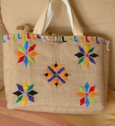 Burlap bag hand embroidery with wool and double handle.Items similar to Burlap bag on Etsy Phulkari Embroidery, Embroidery Bags, Hand Embroidery Designs, Embroidery Patterns, Embroidery Stitches, Burlap Crafts, Craft Bags, Jute Bags, Fabric Bags
