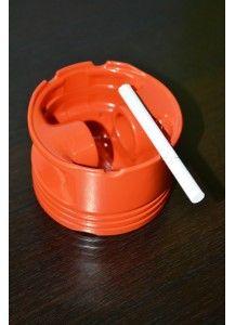 Bright orange ashtray Ashtray made from a car piston. The piston was sandblasted and powdercoated in bright orange.