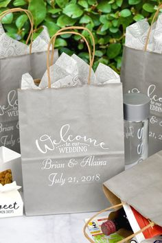 Welcome Bags for Wedding Guests - Pamper your wedding hotel guests with welcome bags filled with treats and comfort items to make their overnight or weekend wedding stay more enjoyable and memorable. Add sunglasses and some lip balm if everyone is going to be outside for your ceremony and/or reception. Add local treat favorites or a bottle of wine or champagne. Personalized gift bags like these can be designed at…