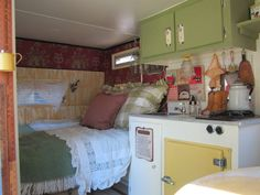 Love this interior of vintage camper - this is about how my future one looks like (with out the cutsey stuff - just where the bed is and sink/stove/fridge combo.