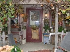 I love the way this porch is decorated...so cozy!
