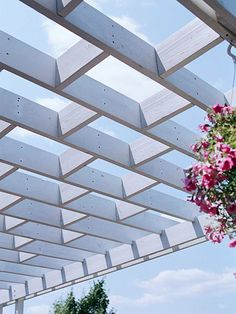 Style Overhead - A contrasting pergola adds more architectural interest to the back of the house and provides partial shade for diners underneath.