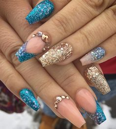 Blue and nude nails that sparkle.