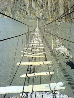 This is the Hussaini Suspension Bridge that links Zarabad Village to Hussain Village near Passu in northern Pakistan.