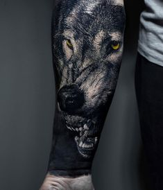 A realistic snarling wolf done on guy's forearm.