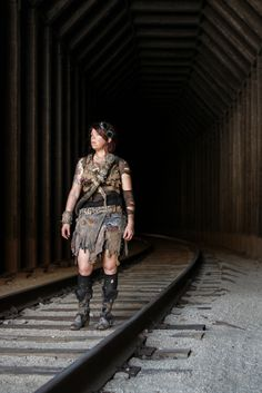 Post apocalyptic girl. DIY homemade costume. Cosplay in abandoned railroad tunnel.