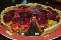 I bought way(!) too many beets at the farmers market last week and needed a new way to use them. I find that I never tire of a hearty dinner tart, beets are always lovely with goat cheese, and who doesn't love a caramelized onion?! Thus, this tart. I riffed on a whole-wheat olive oil crust recipe I had, adding orange zest to it, and in general, kept things simple. We liked this a lot, and prefered it at room temp.