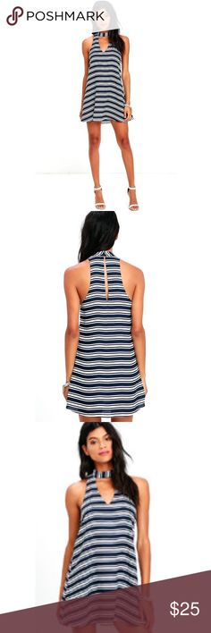 Starboard Side Striped Swing Dress Super versatile ivory and navy blue striped dress! Made out of 100% polyester. Has white lining so it isn't see through. Hidden hook and eye closure on the back of the neck. It's an XL because that was the only size left and I wanted it so badly- I usually wear a medium (6-8) so it fits like a cute oversized swing dress! Lulu's Dresses