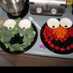 Oscar the grouch and Elmo veggies trays Elmo fruit tray- watermelon, strawberry, blue berries/ black berries, orange slices. with a fruit dripping sauce
