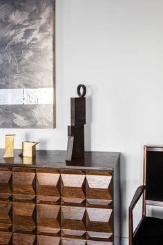 FINE LINES | A Belgian Brutalist sideboard beneath a Brendan Lynch piece in the dining...