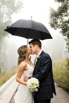 bride and groom under an umbrella   Snowbird Utah Wedding Logan Walker Photography