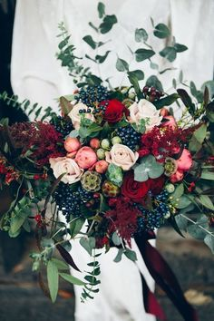 burgundy and navy winter wedding bouquets / http://www.deerpearlflowers.com/burgundy-and-navy-wedding-color-ideas/ used lots of lovely silver eucalyptus at different levels with mentha and velvet grand prix roses contrasted with scabiosa seed pods and elderberries, basically a bunch of lusciousness.