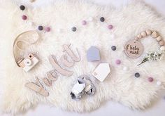 F U R R Y  F R I D A Y ' S Ok I don't even know what that means but it's been a long week and my brain hurts so Furry Friday it is! This beautiful flatlay featuring our Marshmallow Storm Felt Ball Garland from @mish_m_ is getting us through the day! Tap for deets - maybe some retail therapy is in the cards!