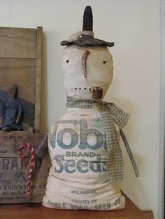 primitive snowman...if i was to make him i think i'd give him a smile...lol