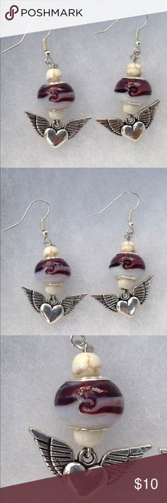 Murano Glass Angel Wing Earrings These pretty earrings are made with purple and white swirled murano glass beads. They are accented with natural howlite and feature a cute heart with angel wings. The hooks are sterling silver plated.   All PeaceFrog jewelry items are made by me! Take a look through my boutique for more unique creations. PeaceFrog Jewelry Earrings
