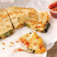 Three-Cheese Quesadillas Recipe -You'll swear you're at a restaurant when you take a bite of this quesadilla. I like to make it with low-fat ingredients. —Sandy Smith, Saugerties, New York