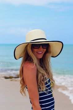 beachy sun hat and blue & white striped coverup