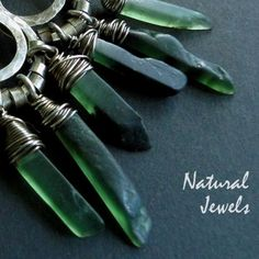 handmade silver earrings with sticks of the green gemstone Serpentine.