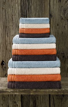 Gamme bath linen 'Imagine', designed especially for a luxurious wellness experience. #bath #linen #towel #collection #sauna #wellness #shower #bathroom #colour #combination #brown #taupe #orange #beige #blue #oxyde #wood #dewittelietaer #dwl