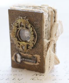 Repurposed book. Made to look antiqued and frankly...irresistible. Could be made into a photo album or just eye candy for your shelf. Love.
