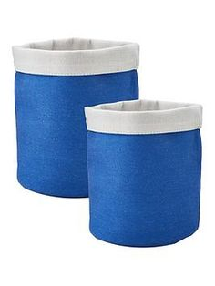 Set of 2 Reversible Fabric Storage Baskets - Blue From craft essentials to make up brushes or small household clutter, this set of 2 reversible storage baskets helps to keep your surfaces clean and tidy. Each one is made from soft fabric, so they'll keep contents inside safe and free from damage or scratches, and they're both brought to life by a bold blue exterior and white interior. With one measuring 25 x 20 cm, and the other at 22 x 18 cm, they look great sat on a shelf or dressing table, Washing Basket, Fabric Storage Baskets, A Shelf, Organizing Your Home, Dressing Table, Storage Containers, Clutter, Contents, Linens