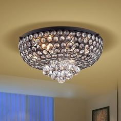 This Francisca 4-light Antique Black Flush Mount Crystal Chandelier is surely to stand out in your home. Visitors will admire the crystal and iron of the chandelier and it will certainly add something extra to your entryway, living room, or dining room.