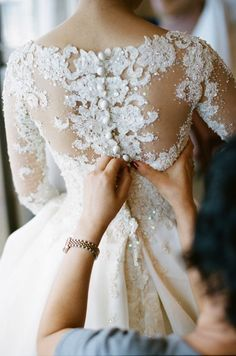 Be sure to factor in enough time to get into your dress on the morning of your wedding! (photo by Erin Hearts Court via Elizabeth Anne Designs)