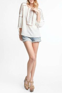 This 3/4 sleeve top with tribal embroidery and balloon tie sleeve detail in off white has a flirty fun look to it. Pair with denim shorts or jeans and your favorite wedge shoes.   Tribal Embroidered Top by She & Sky. Clothing - Tops - Long Sleeve New York