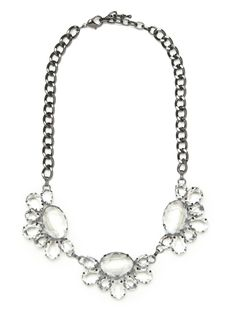 What could be more spectacularly festive than this? A bold gem encrusted collar necklace is carefully crafted from an abstract floral wreath motif.
