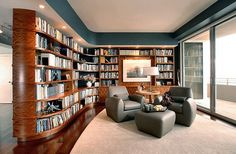 home library design - love the wood shelves and natural light