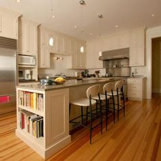 Kitchen island- love the book shelf on the end