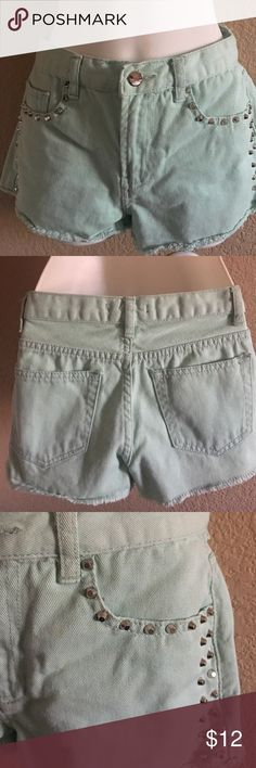 Cut Off Jean Shorts Cute light turquoise cut off shorts , good condition, with silver studs on the side pockets Forever 21 Shorts Jean Shorts