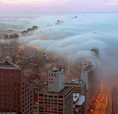 Blanket: Photographer John Harrison, 60, captured the breathtaking scenes from his home office in the 98-floor skyscraper