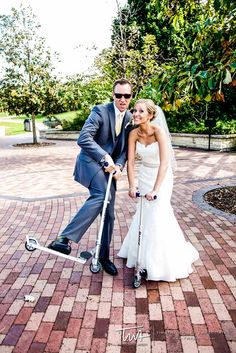 Scooters to ride around on for this bride and groom!