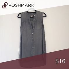 Grey Shirt Dress Sleeveless grey shirt dress or tunic. Lovely shape and silhouette on the body.  Has curved hems and front pocket detail. No collar for a minimalist/utilitarian look. Love this dress, just doesn't get enough sunlight in my closet! Merona Dresses
