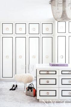large closet with white built-ins, black details, brass pulls, classy closet designs