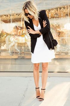 Go modern chic in black and white for your next date night. Keep it sleek by layering a crisp white sundress with a black boyfriend blazer and black strappy heels.