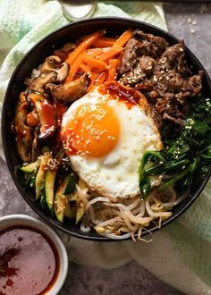 Overhead photo of Bibimbap, Korean Rice Bowl, ready to be eaten Simple Food Recipes, Food Recipes Homemade Asian Recipes, Beef Recipes, Cooking Recipes, Healthy Recipes, Ethnic Recipes, Kitchen Recipes, Good Food, Yummy Food, Korean Dishes