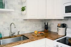 kitchen wall of tile backsplash, butcher block countertop, white cabinets Kitchen Faucet Reviews, Home Kitchens, Kitchen Remodel, Kitchen Wall, Cabinet, Butcher Block Countertops, Painting Kitchen Cabinets, Big Kitchen, Kitchen Cabinets