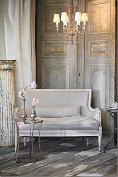 Gustavian style of the period 1746-1792, white wash and pale coloured furniture and furnishings with an aged look with pastel grey linen upholstery.