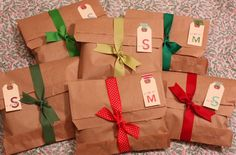 Paper bags folded over & tied with ribbon look great, especially in a bunch. Good for party goody bags placed in a basket.