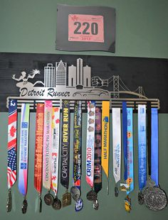 Race Medal Holder - multiple bars across.  The sign could have 2 Timothy 4:7?