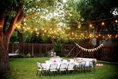 Create a beautiful scene for your backyard #wedding with smartly hung lighting!