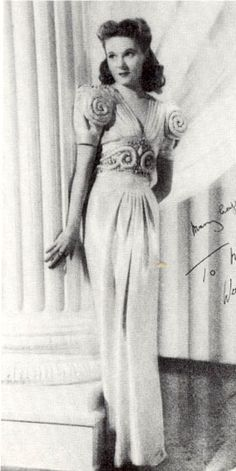 Ann Todd dressed as a Greek Column in the film 'Ships with Wings' 1942. Norman Hartnell dressed Ann Todd