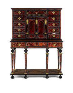 A Flemish 17th century gilt metal and brass mounted ivory inlaid tortoiseshell rosewood ebony and ebonised cabinet