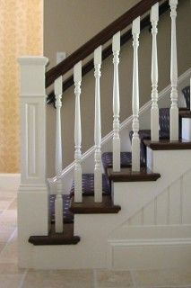 Paint stair railing white and stain wood